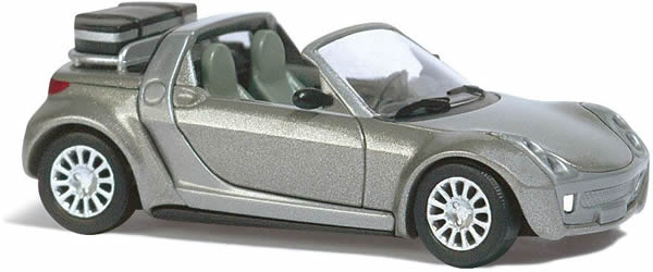 Busch 49302 - Smart Roadster Traveler with suitcase