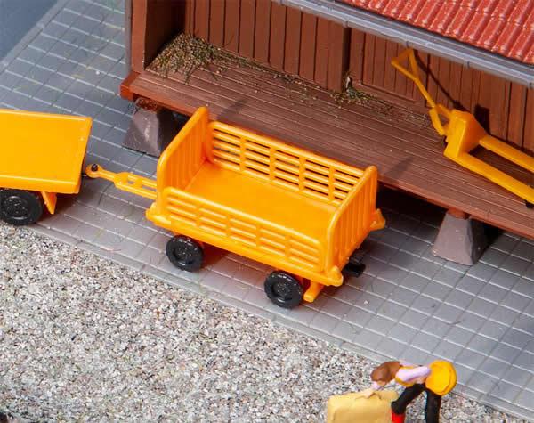 Faller 180991 - 2 Baggage trolleys, orange