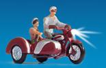 Motorcyclists, illuminated