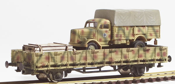 REI Models 460311SAC - German WWII Opel Blitz  in Ambush Camo loaded on a heavy 4 axle DRB flat car