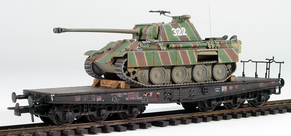 REI Models 6870228 -  German WWII Panther Summer Striped Camo with battle damage loaded on a heavy 6 axle DRB flat car