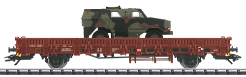 Trix 24119 - German Stake Car loaded w. Camouflauged Dingo of the DB AG